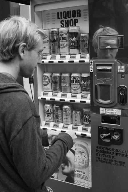 Aaron buys beer from a vending machine