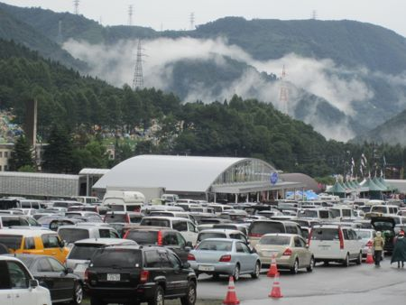 Clouds and cars clog the valley